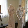 Sally Helen Price's wedding dress from 1892 and her daughter, Helen Holladay's wedding dress from 1933 were on display with their portrait and picture, respectively.